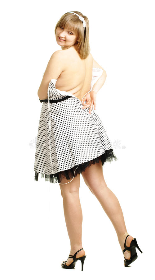 Essais de femme enceinte pour adapter la robe images libres de droits