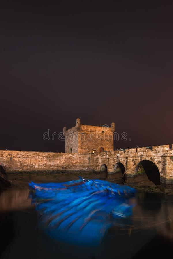 Essaouira port in Morocco. Blue fishing boats of Essaouira at night. Africa stock images