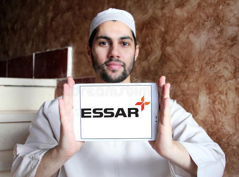 Essar Group logo. Logo of Essar Group on samsung tablet holded by arab muslim man. Essar Global Fund Limited is an Indian conglomerate group. The Fund is a royalty free stock photos