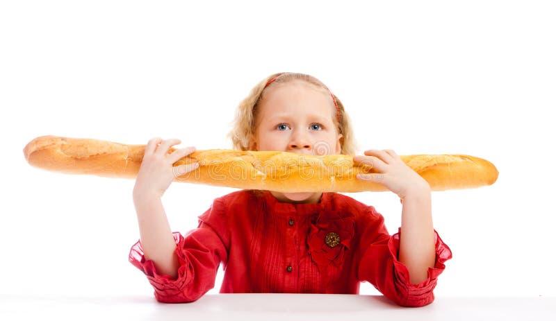 Essen des Brotes stockbild