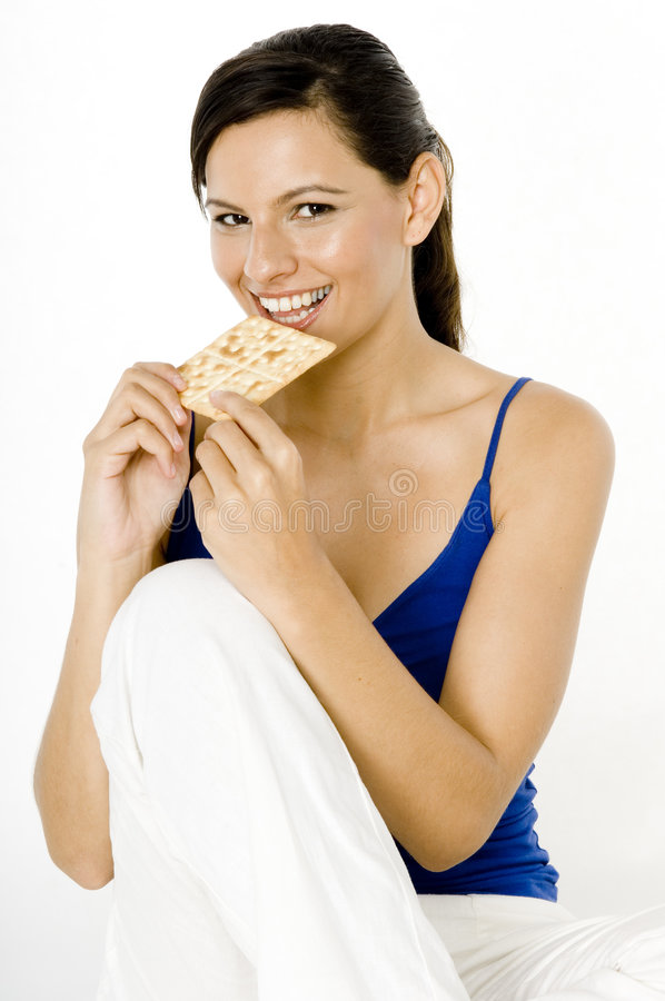 Essen des Crackers lizenzfreie stockfotos
