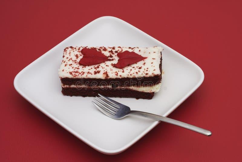 Essen des Kuchens stockfotos