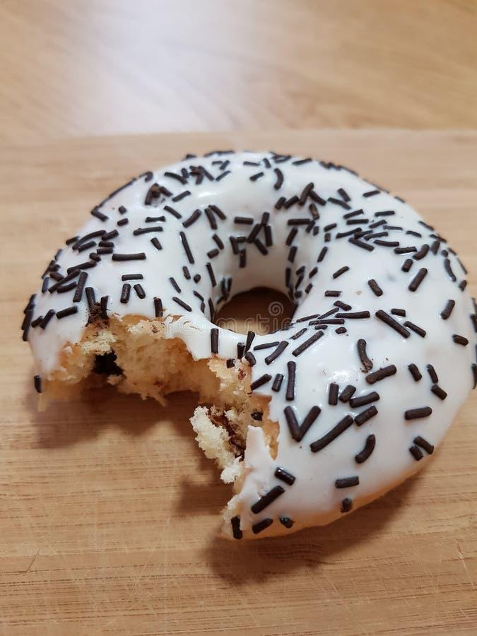 Essen Sie den Donut stockbild