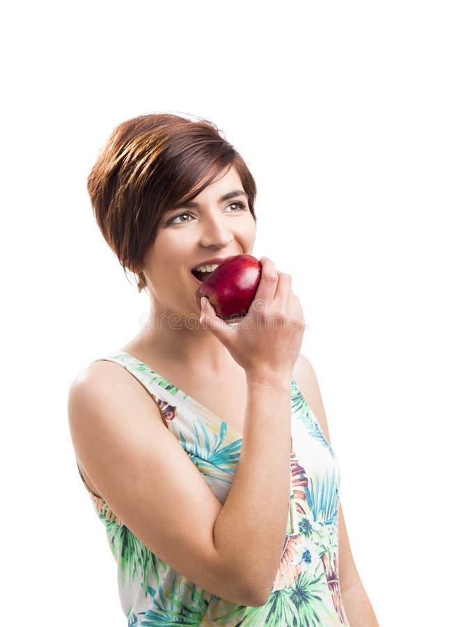 Essen von einem Apple lizenzfreies stockbild