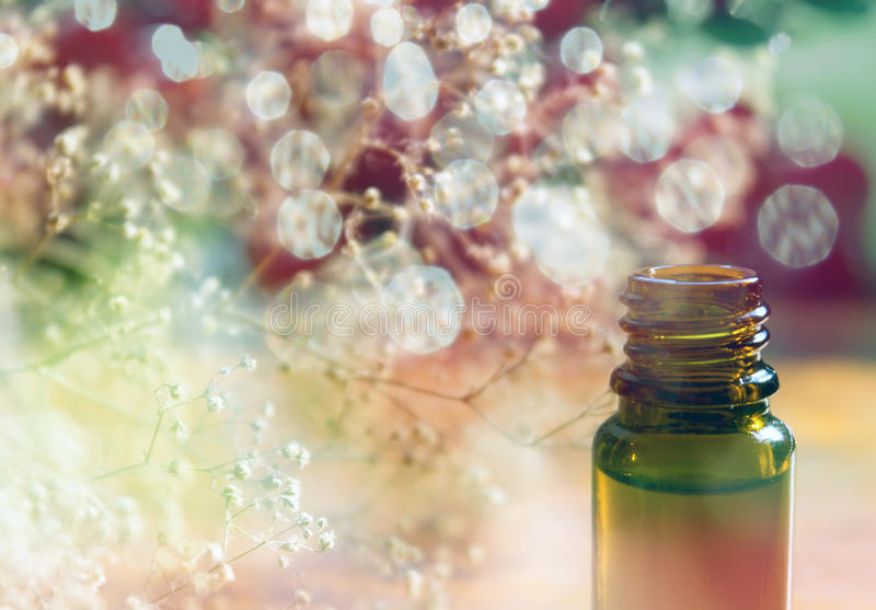 Essence bottle and colorful bokeh royalty free stock photos