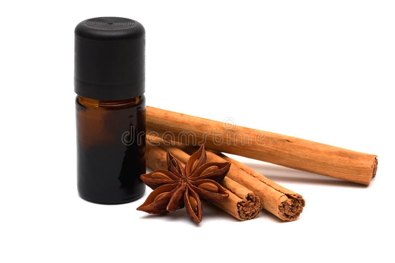 Essence with cinnamon sticks and anice stock image