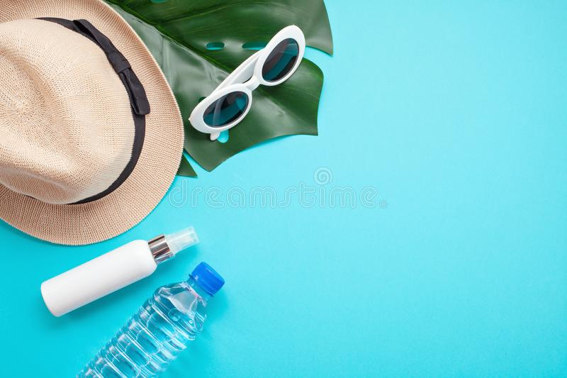 Essential accessories for summer heat: sunglasses, hat, sunscreen, bottle of water. Flat lay, top view. Essential accessories for summer heat: sunglasses, hat stock photos