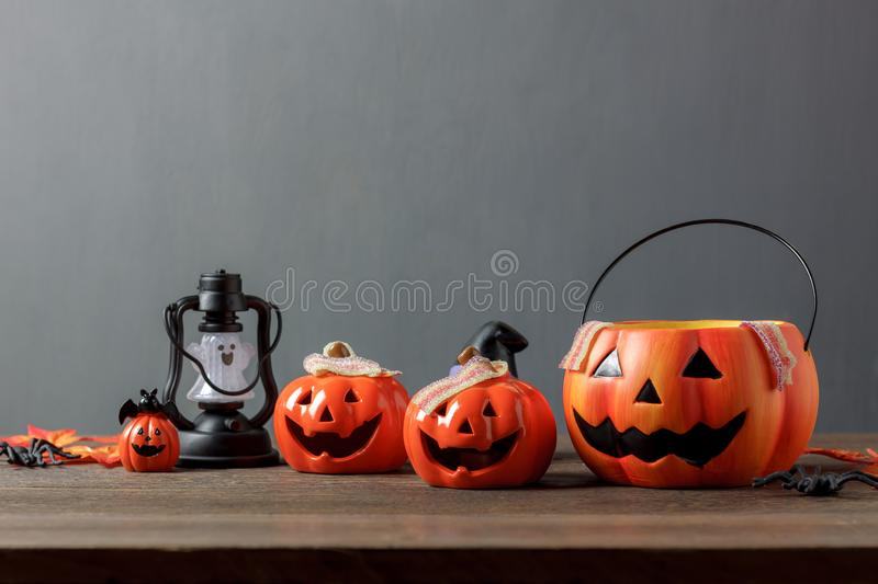 Essential accessory of Happy Halloween decorations festival concept background. Mix variety items on modern rustic brown wooden at home office studio desk.Blur stock images