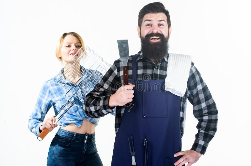 Essential barbecue dishes. Picnic and barbecue. Family getting ready barbecue. Barbecuing common technique. Cooking. Together. Bearded hipster and girl hold stock photos