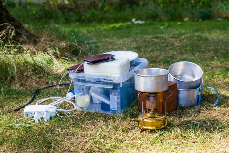 Camping equipment on a campsite stock image