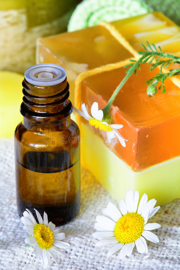 Essential chamomile oil with natural soap stock photography