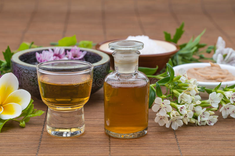 Essential Oil, flower float on water, salt bowel and mask for he. Alth spa royalty free stock images
