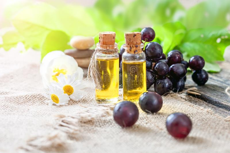 Essential oil of grape seeds on a wooden table stock images