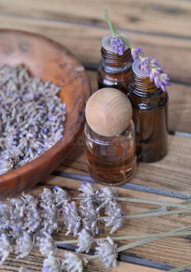 Essential oil from lavender  in bottle and  dried flowers royalty free stock photo