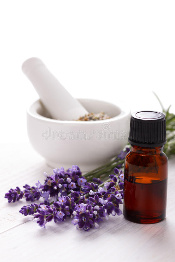Essential oil and lavender flowers stock image
