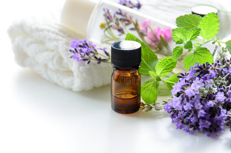 Essential oils and cosmetics with lavender and herbs stock images