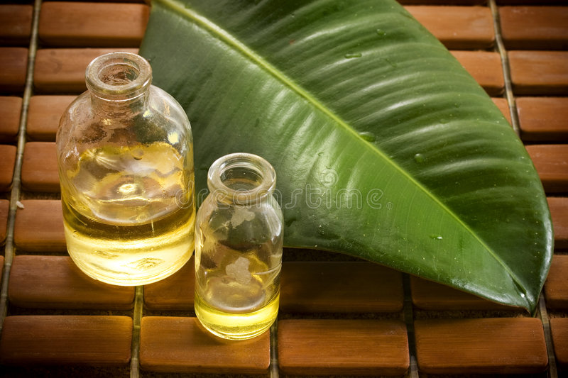 Essential oils in glass bottles stock image