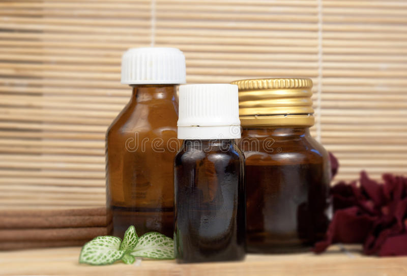 Essential oils rose petals and aroma sticks for spa royalty free stock photography