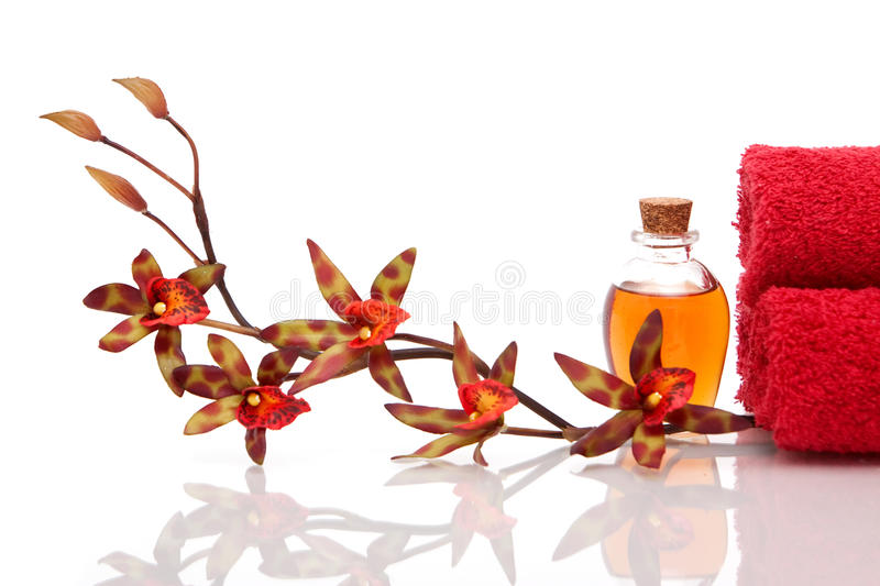 Essential oils, towels and orchid royalty free stock images