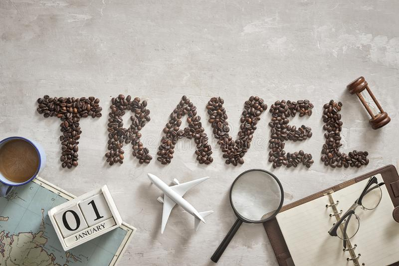 Essential things for traveller with Travel letter from coffee bean on the floor.  stock photos