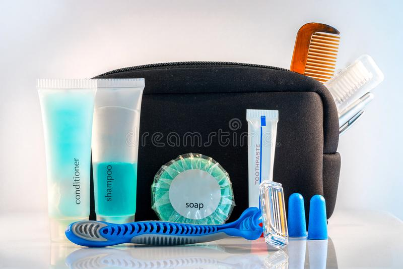 Essential travel kit. Depicting the essential travel kit consisting of everyday items like toothbrush and shampoo royalty free stock photos