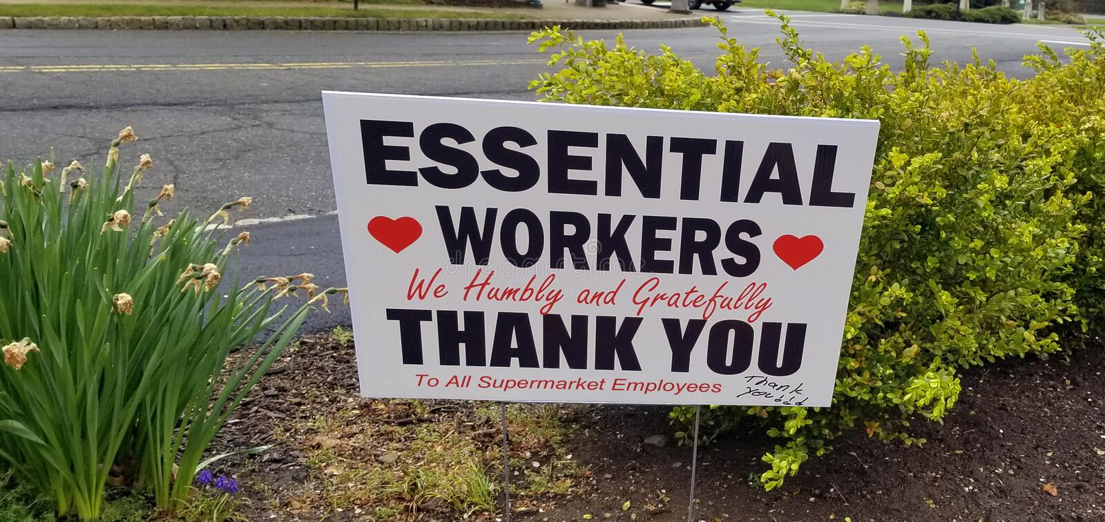 Essential Workers Sign royalty free stock photo