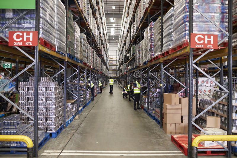 ESSEX, ENGLAND- MAR 13 2016: Stored goods in supermarket distribution warehouse, low angle stock image