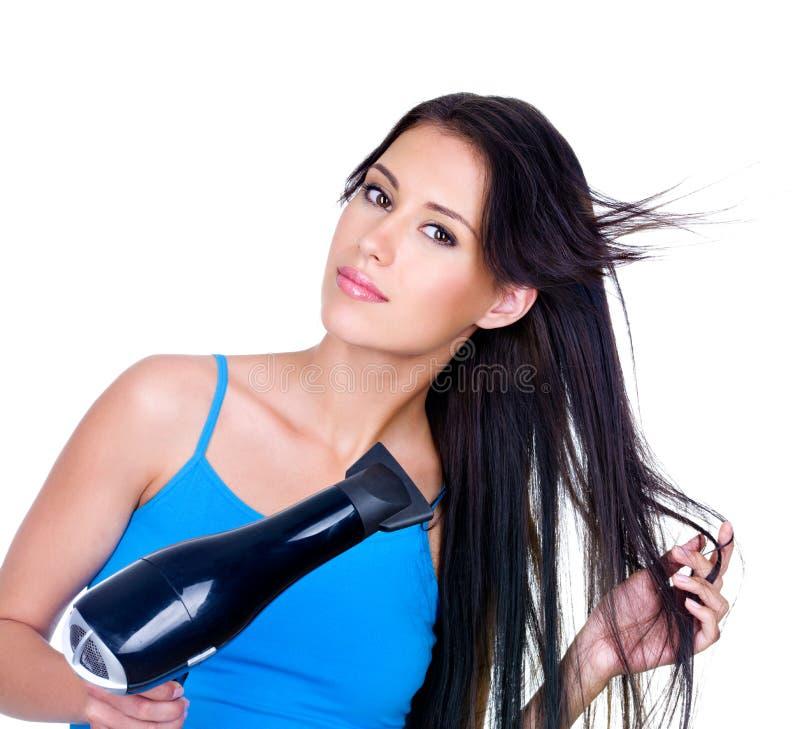 Essiccamento dei capelli lunghi della donna fotografia stock