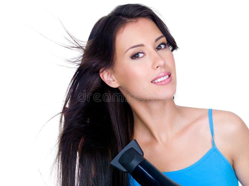 Essiccamento della donna di sensualità i suoi capelli immagine stock