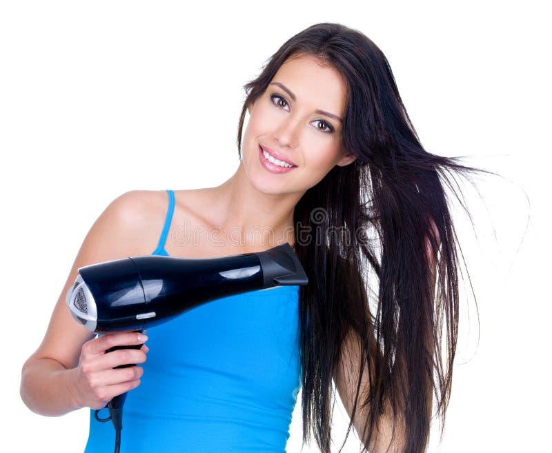 Essiccamento della donna i suoi capelli fotografia stock