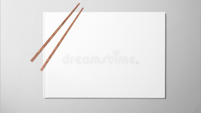 Essstäbchen auf Weißbuch auf sauberem Hintergrund lizenzfreie stockbilder