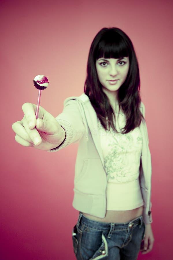 Está aqui um lollipop. fotografia de stock