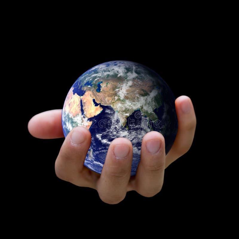 Está en sus manos? Sostener la tierra imagen de archivo