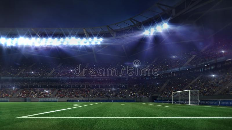 Estádio de futebol grande iluminado por projetores e pela grama verde vazia imagem de stock royalty free
