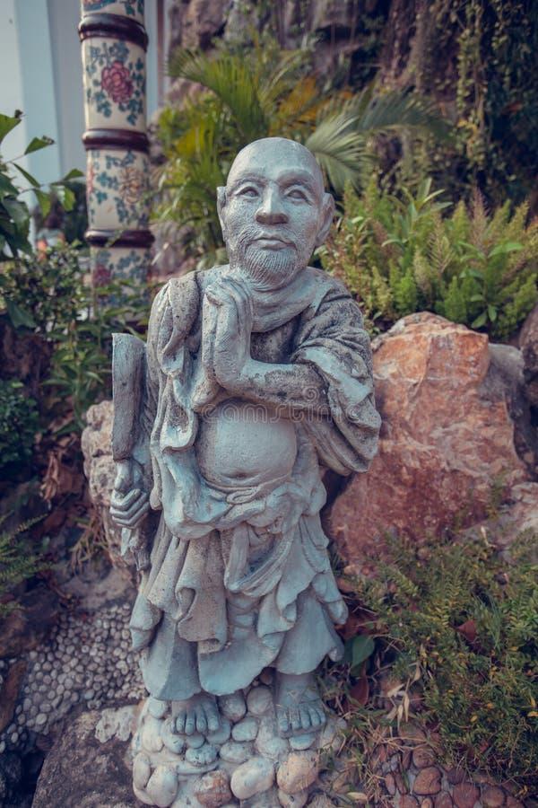 Estátua chinesa da pedra da monge de Wat Pho Banguecoque, Tailândia fotografia de stock