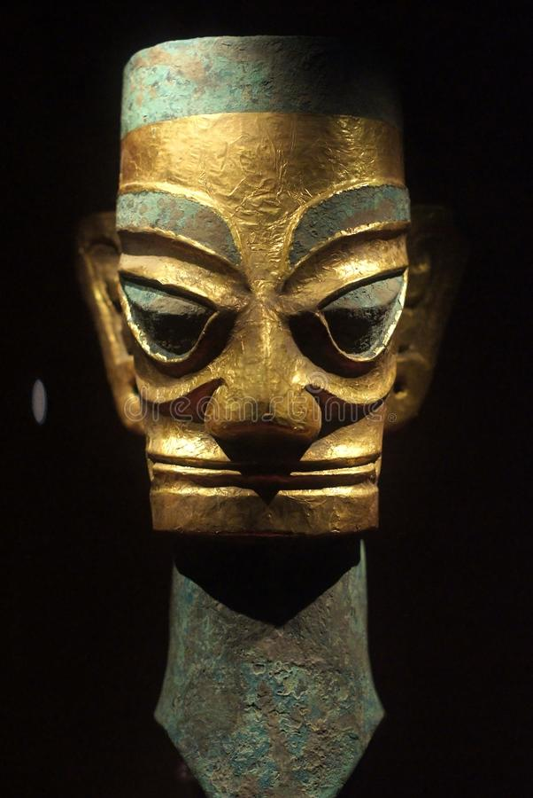 Estátua de bronze China da máscara imagem de stock royalty free
