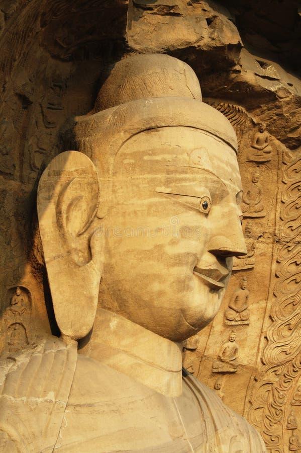 Estátua de Buddha em cavernas de Yungang fotografia de stock
