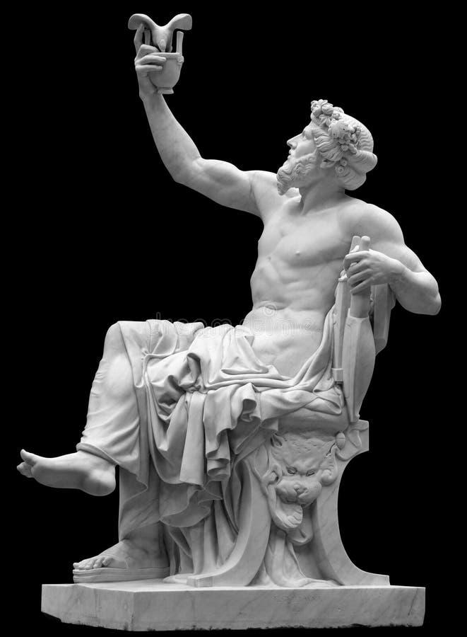 Estátua de Dionysus ou de Baco com grupo de uvas isoladas no branco foto de stock