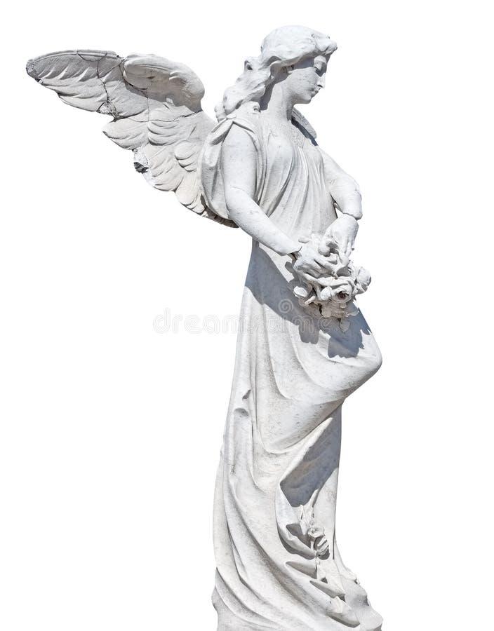 Estátua de um anjo com as flores isoladas fotografia de stock royalty free