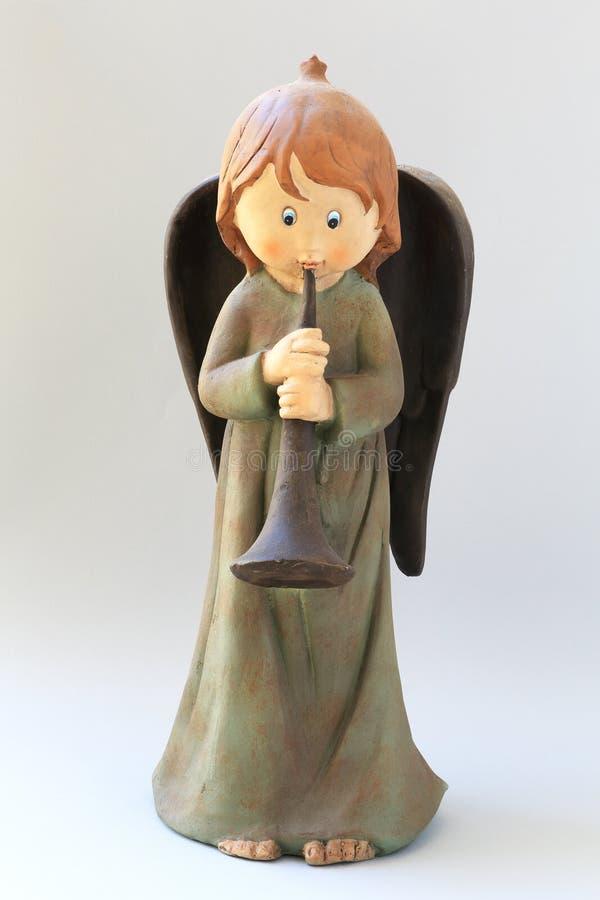 Estátua do anjo da criança com trombeta ilustração royalty free