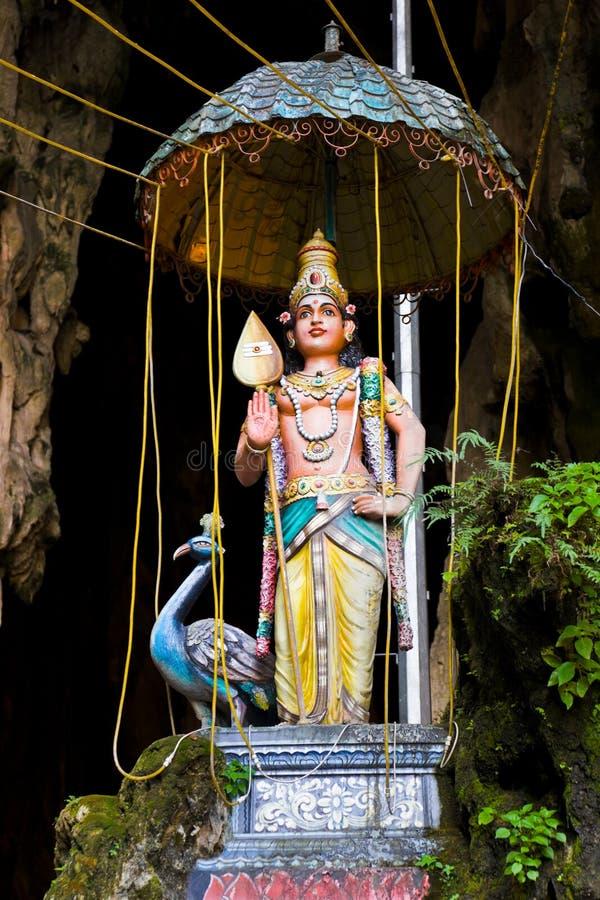 A estátua do deus em Batu desaba, Kuala Lumpur fotografia de stock royalty free