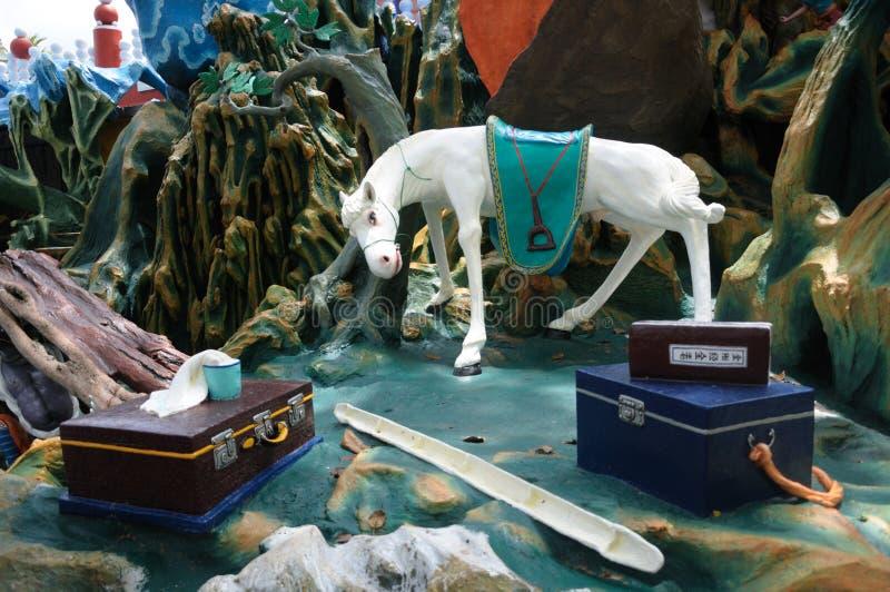 Estátua do passeio do cavalo do ` s de Tripitaka na casa de campo da paridade do espinho em Singapura imagem de stock