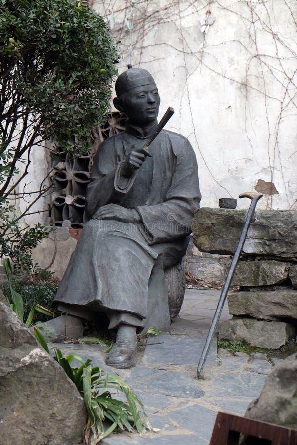 Estátua em Xitang Ming e em exposição salão de Qing Dynasty Residence Wood Carving, cidade de Xitang, China imagem de stock