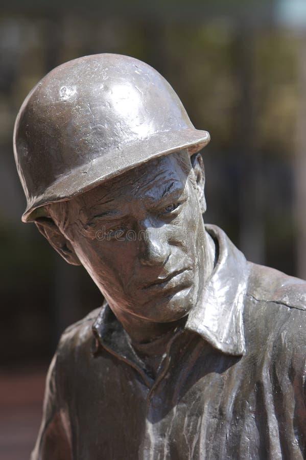 Estátua no homem com chapéu duro imagem de stock