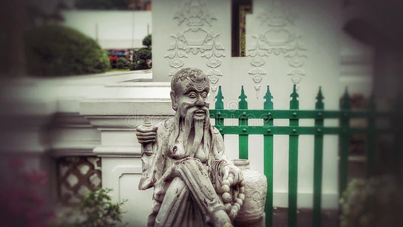 Estátua no templo de Arun, Banguecoque fotografia de stock
