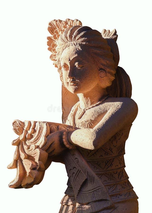 Estátua tradicional da mulher do arenito do Balinese, oferecimento bem-vindo em suas mãos imagem de stock