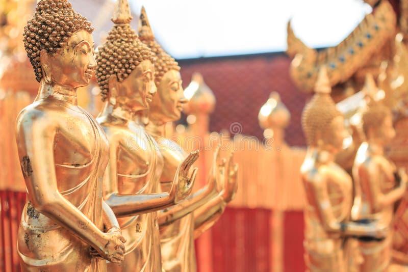 Estátuas da Buda no templo fotografia de stock royalty free