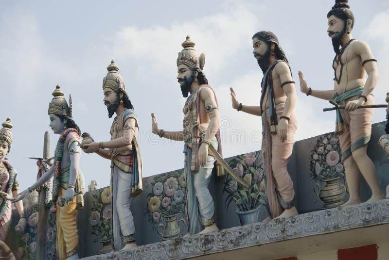Estátuas humanas no templo indiano fotos de stock