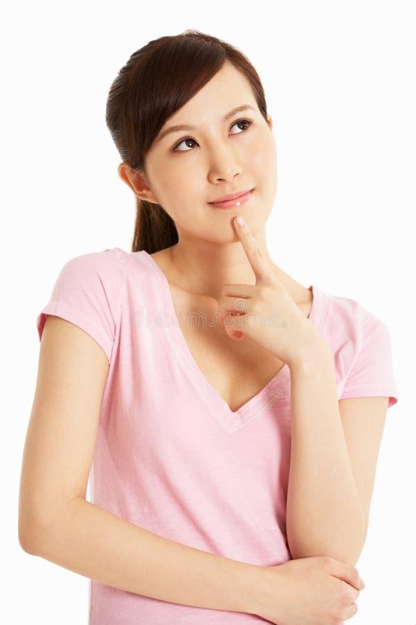 Estúdio disparado da mulher chinesa pensativa imagens de stock royalty free