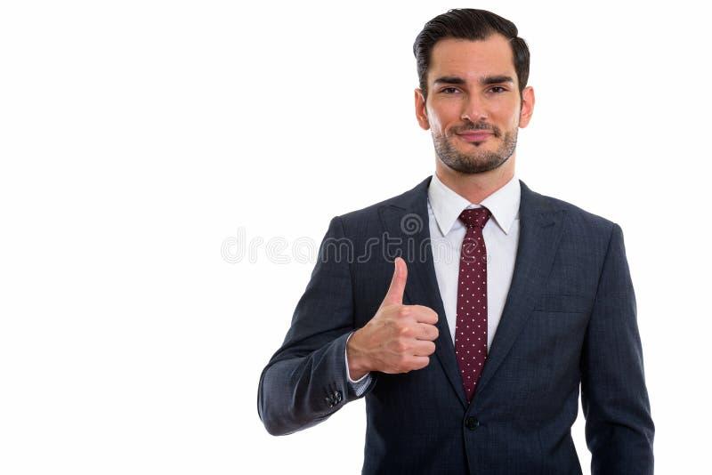 Estúdio disparado do homem de negócios considerável novo que dá o polegar acima imagem de stock